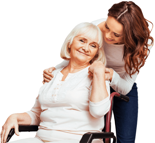 senior woman on wheelchair with her caregiver smiling