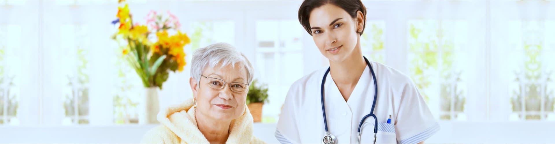 nurse holding senior womans health