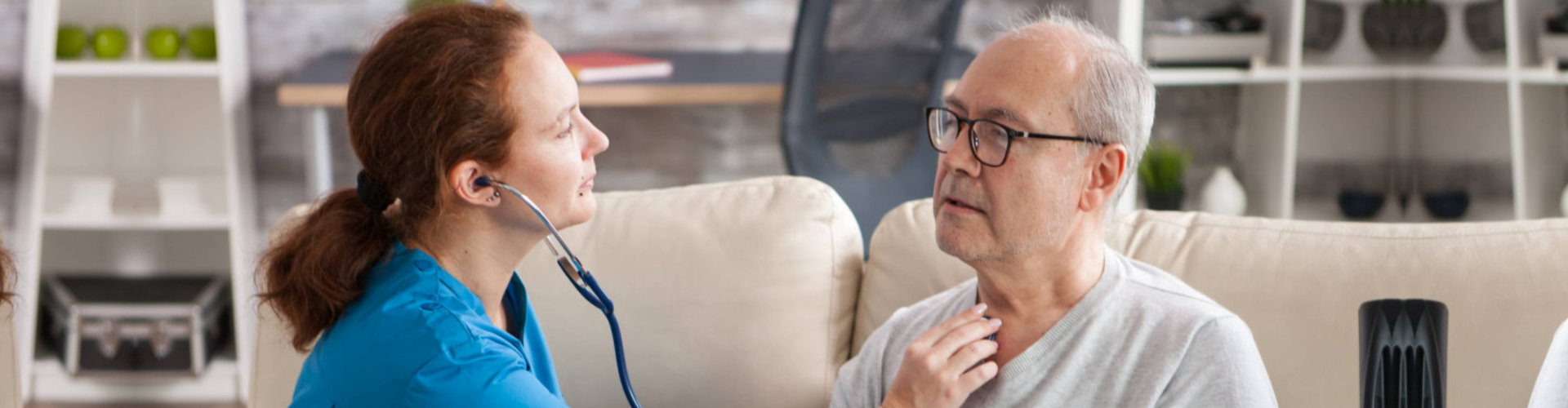 caregiver checking the health of the senior man